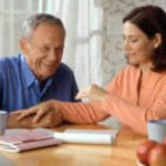 17069-a-woman-and-older-man-sitting-at-a-table-or