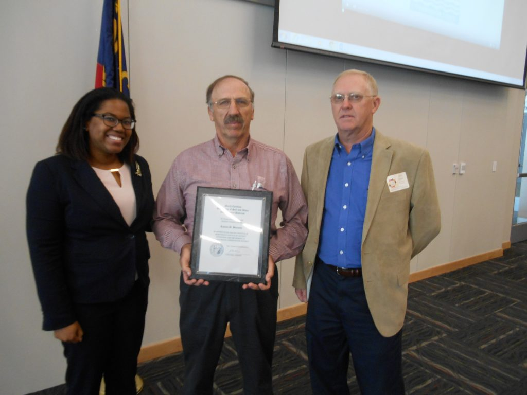 Ben Knox, President of the North Carolina Soil and Water Districts, and Danielle Adams, Area IV Chair of Durham, presented Granville County District Supervisor Ronnie Burnette (center), with his 20 year plaque. The presentation was made at the November 2016 Area Meeting in Durham. Burnette serves as Chairman of the Granville Soil and Water Board.