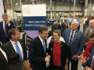 Governor Roy Cooper greets Oxford Mayor, Jackie Sergent.
