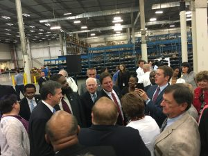 Governor Roy Cooper greets the crowd after the announcement.