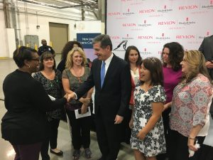 Governor Roy Cooper greets Revlon employees.