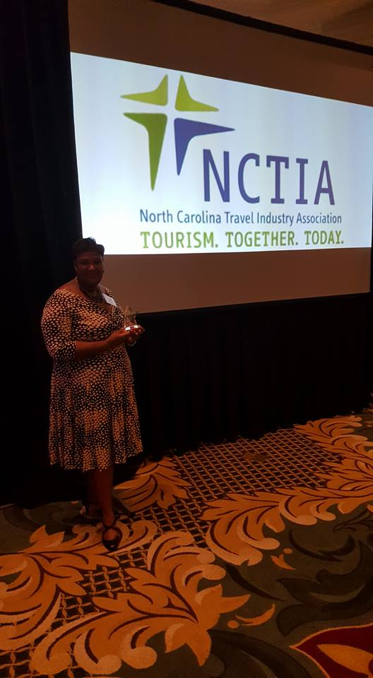Angela Allen poses with state tourism award