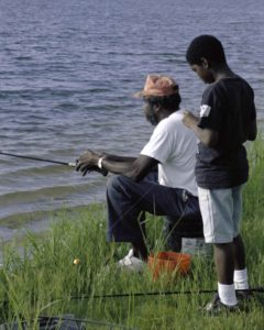 afro-american-father-and-son-fishing