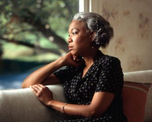 17073-an-african-american-woman-looking-out-a-window-or