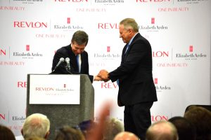 Governor Roy Cooper gives NC flag to Revlon