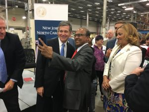 Governor Roy Cooper greets audience members.