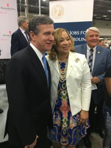 Governor Roy Cooper greets the Superintendent of Granville County Schools, Dr. Alisa McLean.