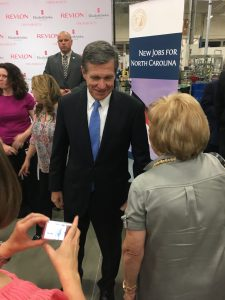 Governor Roy Cooper greets Granville County Chamber of Commerce Executive Director, Ginnie Currin.