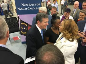 Governor Roy Cooper greets the Superintendent of Granville County Schools.