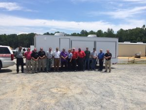 Representatives posing from the counties that received a trailer.