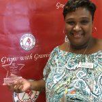 Angela Allen, TDA Director, posing with her Rising Star Award