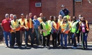 county employees with safety vests